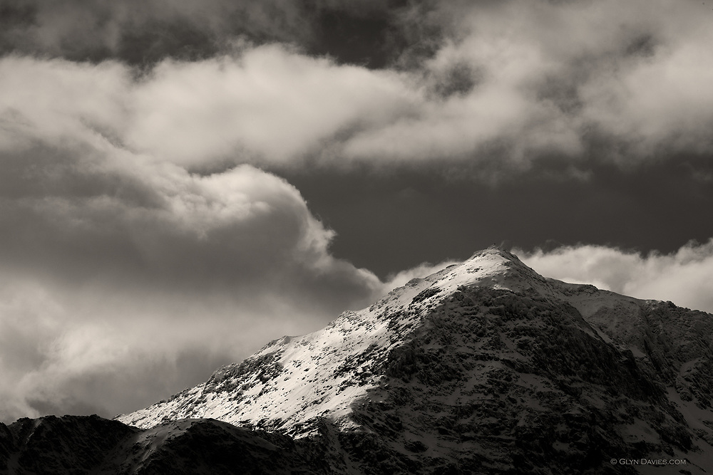 Snow & ice cover the ridges of Yr Wyddfa (Snowdon) Wales' highest peak.