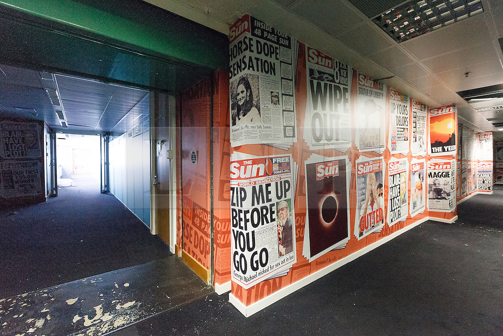 © Licensed to London News Pictures. 24/09/2012. London, UK. Image date 20/08/2012. The Sun newspaper wallpaper on the sixth floor corridor of the former News International site (Fortress Wapping) in Pennington Street, East London.  On 27 September 2012 the entire site contents will be sold at an online auction. The former News International site was sold to Berkeley Group's, St George in May 2012 who have renamed it 'London Dock' and are planning redevelopment as mixed residential, retail and office use. Photo credit : Vickie Flores/LNP