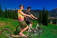 Riding digglers (scooters), Copper Mountain ski resort in summer, Colorado, USA