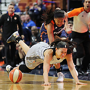 UNCASVILLE, CONNECTICUT- MAY 05:  Morgan Tuck #33 of the Connecticut Sun fouls Dearica Hamby #5 of the San Antonio Stars during the San Antonio Stars Vs Connecticut Sun preseason WNBA game at Mohegan Sun Arena on May 05, 2016 in Uncasville, Connecticut. (Photo by Tim Clayton/Corbis via Getty Images)