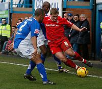 Kris Commons of Nottingham Forest (left) attacks Chesterfield defender Alex Bailey (left)