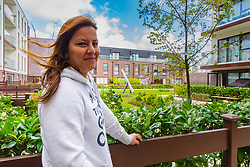 Mother of two Claudia Cifuentes, 39, who is one of the residents whose flat overlooks the gardens and play area. Social housing residents are up in arms after having their children forbidden from using a play area overlooked by their homes as it is said to be only available to the children of those who have bought properties at the new Baylis Old School housing development in Lambeth, South London . London, March 26 2019.