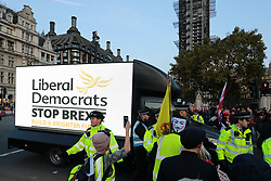 © Licensed to London News Pictures. 31/10/2019. London, UK. Anti-Brexit protesters surround a Liberal Democrat advertising van as they gather in Parliament Square on what would have been the United Kingdom's last day as a member of the European Union. The date of Brexit had been moved to January 31, 2020 after MPs failed to pass Prime Minister Boris Johnson's withdrawal agreement. Photo credit: Rob Pinney/LNP