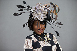 LIVERPOOL, ENGLAND - Friday, April 4, 2014: Cafolin Campbell of Birmingham wearing Asos and a hat from Sharper Millinery of Solihul during Ladies' Day on Day Two of the Aintree Grand National Festival at Aintree Racecourse. (Pic by David Rawcliffe/Propaganda)