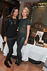 Left to right, ZARA SIMON and TAMARA BECKWITH at the Delicious Glamourous Girls Christmas Bazaar held at The Little Black Gallery & 11 Park Walk, Park Walk, London on 27th November 2012.