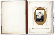 on first page open vintage photo album from late 1800s