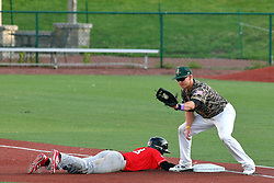 29 July 2016: Connor Oliver dives back to first base as the throw comes to Aaron Dudley during a Frontier League Baseball game between the Lake Erie Crushers and the Normal CornBelters at Corn Crib Stadium on the campus of Heartland Community College in Normal Illinois