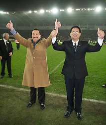CARDIFF, WALES - Tuesday, January 24, 2012: Cardiff City's owners Tan Sri Vincent Tan Chee Yioun (L) and Datuk Chan Tien Ghee celebrate their side's penalty shoot-out victory over Crystal Palace during the Football League Cup Semi-Final 2nd Leg at the Cardiff City Stadium. (Pic by David Rawcliffe/Propaganda)