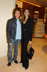 ANDY WONG and designer ISABELL KRISTENSEN at a party hosted by Burberry to launch their special collection in aid of Breakthrough Breast Cancer, held at 21-23 New Bond Street, London W1 on 5th October 2004.<br /><br />NON EXCLUSIVE - WORLD RIGHTS