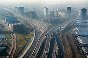 Nederland, Noord-Holland, Amsterdam, 11-12-2013; Amsterdam Sloterdijk, kruising A10 West (Einsteinweg) met A5, naar rechts (Westrandweg). Tegenlichtopname.<br /> Junction of new ringroad Amsterdam. Backlight.<br /> luchtfoto (toeslag op standard tarieven);<br /> aerial photo (additional fee required);<br /> copyright foto/photo Siebe Swart