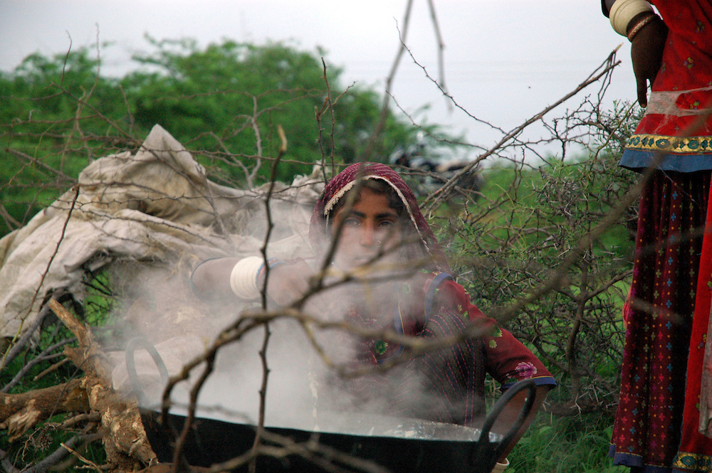 A woman in the bush, boiling milk into mawa ..by Michael Benanav - mbenanav@gmail.com