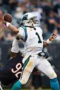 CHICAGO, IL - OCTOBER 22:  Cam Newton #1 of the Carolina Panthers throws a pass and is hit by Pernell McPhee #92 of the Chicago Bears at Soldier Field on October 22, 2017 in Chicago, Illinois.  The Bears defeated the Panthers 17-3.  (Photo by Wesley Hitt/Getty Images) *** Local Caption *** Cam Newton; Pernell McPhee