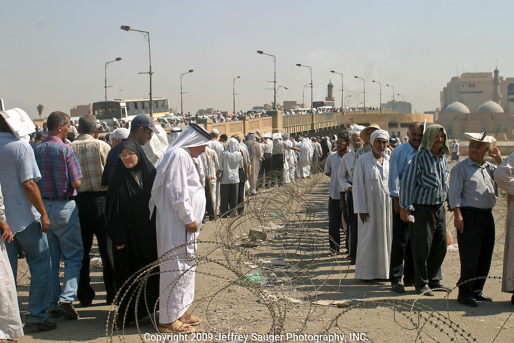 Iraqis waiting in line at an aid office in Baghdad, Iraq.