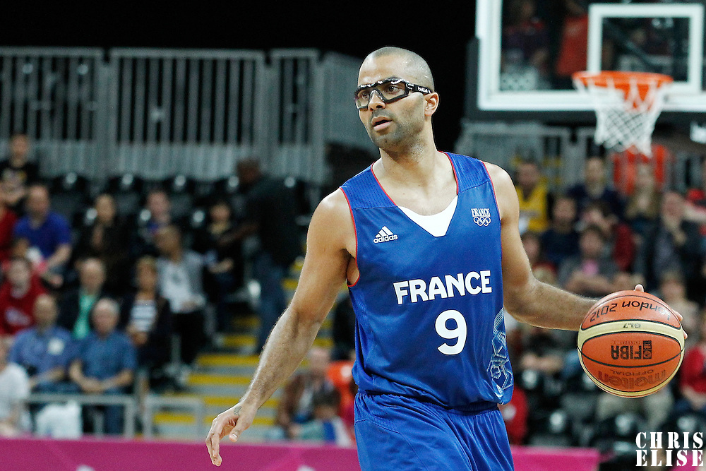 04 August 2012: Tony Parker brings the ball upcourt during 73-69 Team France victory over Team Tunisia, during the men's basketball preliminary, at the Basketball Arena, in London, Great Britain.