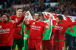 CARDIFF, WALES - Tuesday, October 13, 2015: Wales' goalkeeper Wayne Hennessey, Gareth Bale and Aaron Ramsey celebrate qualifying for the finals following a 2-0 victory over Andorra during the UEFA Euro 2016 qualifying Group B match at the Cardiff City Stadium. (Pic by Ian Cook/Propaganda)