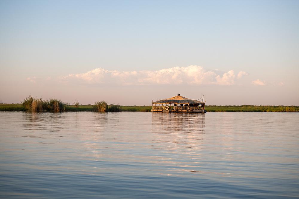 A tiki bar called the Raft, sits along the Chobe River. Chobe National Park - Botswana