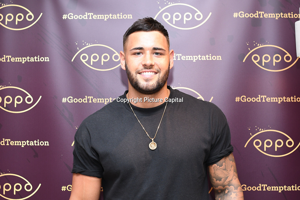 Kieran from Love Island attend the Oppo party to launch its new Madagascan Vanilla, Sicilian Lemon and Raspberry Cheesecakes, served with Skinny Prosecco at Farm Girls Café, 1 Carnaby Street, Soho, London, UK on July 18 2018.