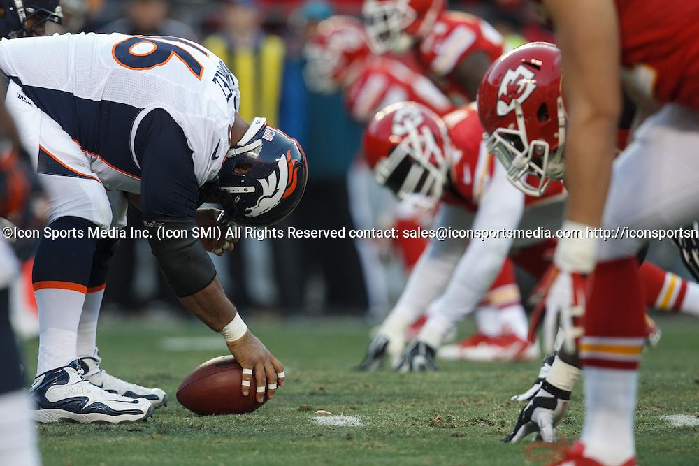 December 1, 2013: Denver Broncos center Manny Ramirez (66) prepares to snap the ball during the Denver Broncos 35-28 victory over the Kansas City Chiefs at Arrowhead Stadium in Kansas City, Missouri.
