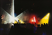 Laser lights, on a sihouetted crowd at a rave, Desire UK 1996