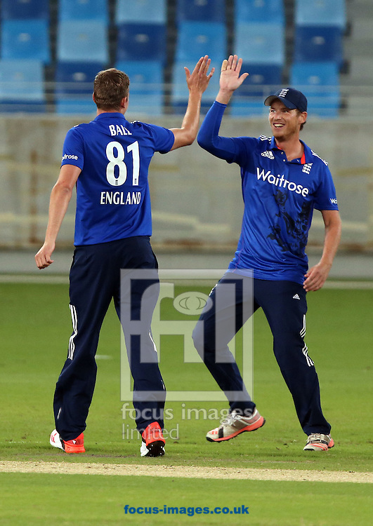 Jake Ball (L) of England Lions takes the wicket of Iftikhar Ahmed of Pakistan A during the International Twenty/20 match at Dubai International Cricket Stadium, Dubai<br /> Picture by Chris Whiteoak-Medcalf/Focus Images Ltd +971 8117530<br /> 10/12/2015