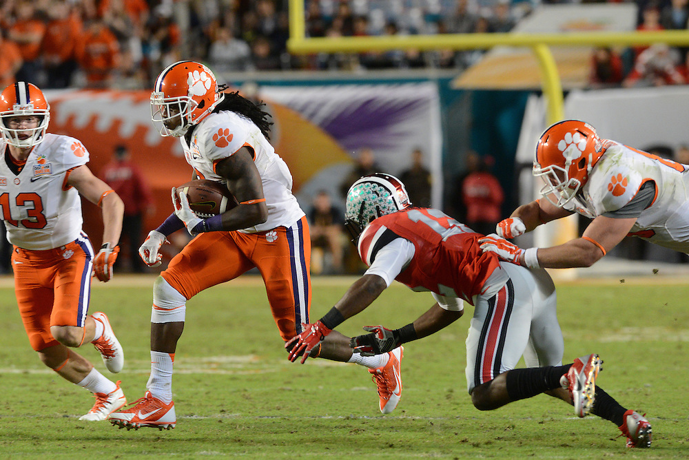 January 3, 2014: Sammy Watkins #2 of Clemson tries to avoid the tackle by Doran Grant #12 of Ohio State during the NCAA football game between the Clemson Tigers and the Ohio State Buckeyes at the 2014 Orange Bowl in Miami Gardens, Florida. The Tigers defeated the Buckeyes 40-35.