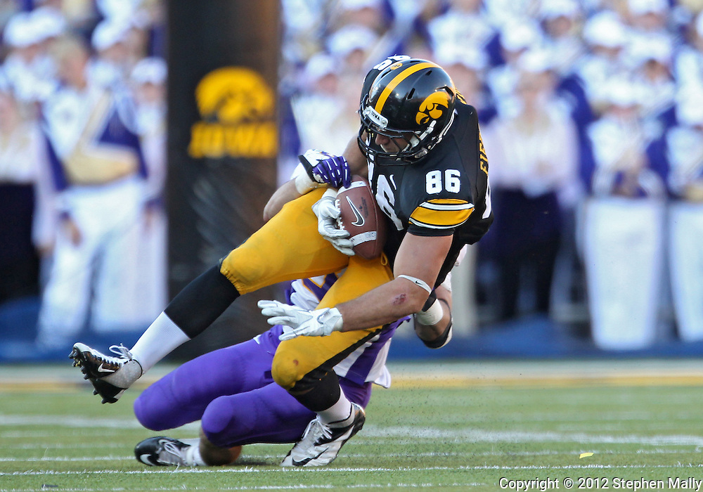 September 15 2012: Iowa Hawkeyes tight end C.J. Fiedorowicz (86) is brought down by Northern Iowa Panthers linebacker Jordan Gacke (35) after a catch during the second half of the NCAA football game between the Northern Iowa Panthers and the Iowa Hawkeyes at Kinnick Stadium in Iowa City, Iowa on Saturday September 15, 2012. Iowa defeated Northern Iowa 27-16.