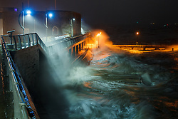 © Licensed to London News Pictures. 14/02/2014. Southsea, Hampshire, UK. Waves smashing against the historic fortification walls in Old Portsmouth in Southsea, Hampshire, UK. Strong winds have battered the south coast, with hurricane force 12 winds being forecast. Photo credit : Rob Arnold/LNP