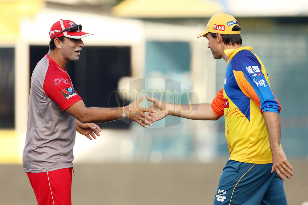 Azhar Mahmood greets Stephen Fleming during a practice session of the Chennai Super Kings and Kings XI Punjab in the the Indian Premier League ( IPL) 2012 held at the M. A. Chidambaram Stadium, Chennai on the 27th April 2012..Photo by Jacques Rossouw/IPL/SPORTZPICS