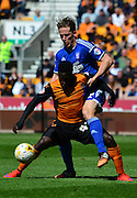Tommy Smith attempts to tackle Nouha Dicko during the Sky Bet Championship match between Wolverhampton Wanderers and Ipswich Town at Molineux, Wolverhampton, England on 18 April 2015. Photo by Alan Franklin.