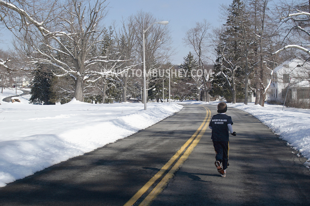 Middletown, NY - A young boy warms up for a road race on a cold winter morning on Feb. 24, 2008.