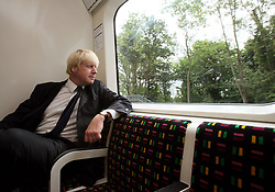 London Mayor Boris Johnson inside the first new air-conditioned train in London as part of a scheme to have 40\% of tube trains air-conditioned by 2015.
