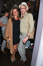 HENRY CONWAY and STEPHANIE BILET at a party to celebrate the opening of Bunga Bunga - a new Pizzeria & Bar, 37 Battersea Bridge Road, London SW11 on 1st September 2011.