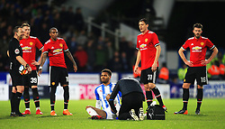 Steve Mounie of Huddersfield Town receives treatment for an injury - Mandatory by-line: Matt McNulty/JMP - 17/02/2018 - FOOTBALL - The John Smith's Stadium - Huddersfield, England - Huddersfield Town v Manchester United - Emirates FA Cup Fifth Round