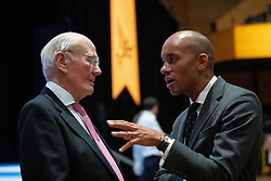 © Licensed to London News Pictures . 17/09/2019. Bournemouth, UK. MENZIES CAMPBELL and CHUKA UMUNNA chat ahead of the Leader's Speech on the final day of the Liberal Democrat Party Conference at the Bournemouth International Centre . Photo credit: Joel Goodman/LNP
