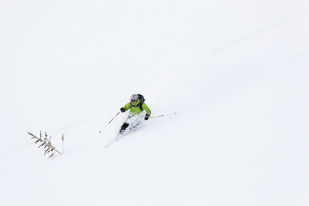Judd MacRae skis deep powder below Hayden Peak, San Juan Mountains, Colorado.