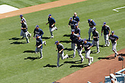 LOS ANGELES, CA - JULY 15:  The San Diego Padres jog while warming up at batting practice before the game against the Los Angeles Dodgers on Sunday, July 15, 2012 at Dodger Stadium in Los Angeles, California. The Padres won the game 7-2. (Photo by Paul Spinelli/MLB Photos via Getty Images)