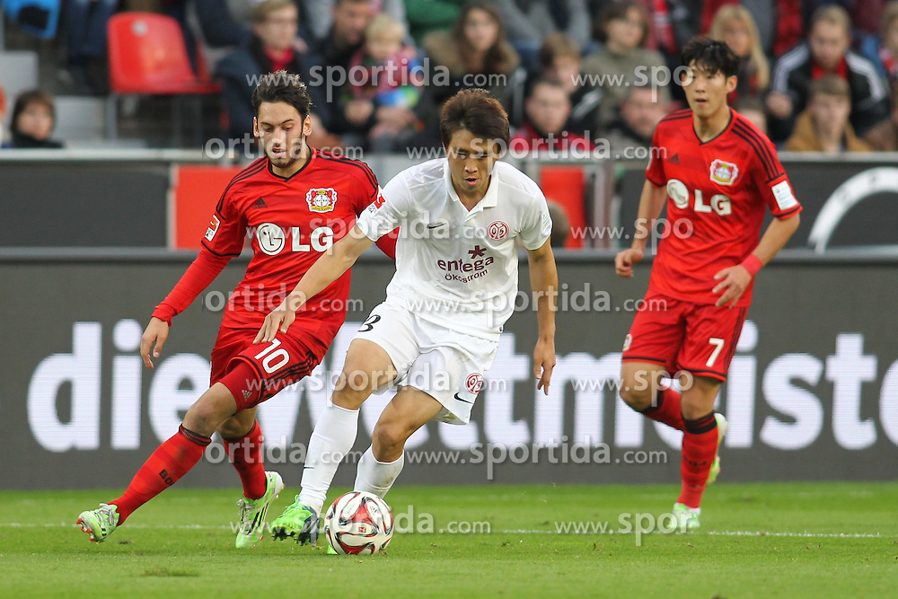 08.11.2014, BayArena, Leverkusen, GER, 1. FBL, Bayer 04 Leverkusen vs 1. FSV Mainz 05, 11. Runde, im Bild vl: Hakan Calhanoglu (Bayer 04 Leverkusen #10), Ja-Cheol Koo (FSV Mainz 05 #13) und Heung-Min Son (Bayer 04 Leverkusen #7) // during the German Bundesliga 11th round match between Bayer 04 Leverkusen and 1. FSV Mainz 05 at the BayArena in Leverkusen, Germany on 2014/11/08. EXPA Pictures &copy; 2014, PhotoCredit: EXPA/ Eibner-Pressefoto/ Sch&uuml;ler<br /> <br /> *****ATTENTION - OUT of GER*****