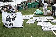A WWF protestor prepares for the Global Day of Action outside the Durban Christian Centre, Durban South Africa, 3 Dec 2011