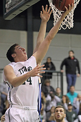 16 November 2013:  Alex Rossi completes a reverse during an NCAA mens division 3 basketball game between the Aurora University Spartans and the Illinois Wesleyan Titans in Shirk Center, Bloomington IL