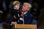 Republican Presidential nominee Donald J. Trump holds two-year-old Hunter Tirpak of Tuscarora, who is dressed as Trump, during a rally at Mohegan Sun Arena in Wilkes-Barre Twp. on Monday, Oct. 10, 2016.<br />