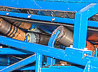 Blue conveyor belts and their machinery parts at the Werdhölzli Sewage Plant, Zürich, Switzerland.