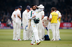 Pakistan's Azhar Ali walks off dejected after getting out for 50 during day two of the First NatWest Test Series match at Lord's, London.