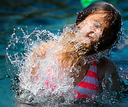 Girl plays in the water in Arlington, Texas.