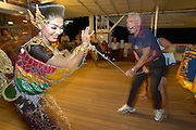 Thai folk show after goodbye Dinner aboard the Star Flyer. Passengers dancing with Thais.