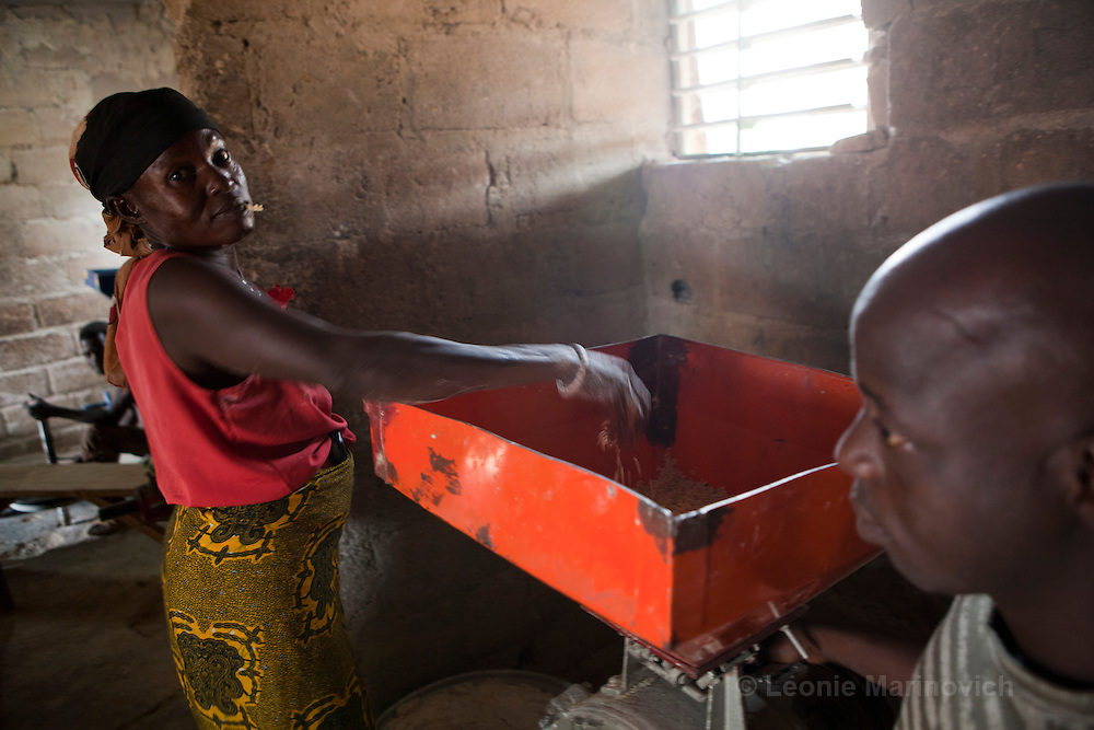 22 June 2010. A flour mill in the town of Zorgho. Women bring their grains that include, maize, millet and sorghum, to be ground into flour.