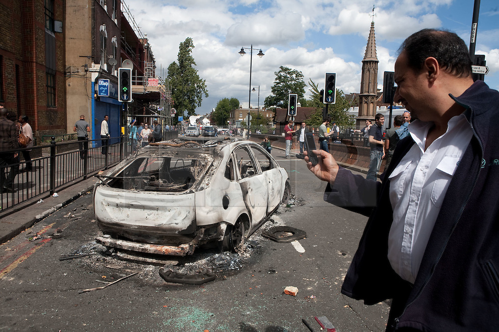 ©London News Pictures. Tottenham, London, UK. 07/08/11. Rioting broke out late last night in Tottenham and the surrounding area after the killing of Mark Duggan, 29 and a father-of-four, by armed police in an attempted arrest in London. Shops in Tottenham and Woodgreen were looted by the rioters/England. Photo credit : Fuat Akyuz/LNP