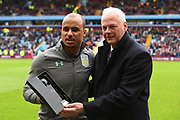 Aston Villa's Gabriel Agbonlahor is presented with an award by Villa's U23 team manager, Kevin MacDonald, in recognition of his final game for Aston Villa after 12 years and nearly 400 appearances since joining Aston Villa in 2006 during the EFL Sky Bet Championship match between Aston Villa and Derby County at Villa Park, Birmingham, England on 28 April 2018. Picture by Jon Hobley.