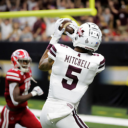 Aug 31, 2019; New Orleans, LA, USA; Mississippi State Bulldogs wide receiver Osirus Mitchell (5) catches a touchdown against the Louisiana-Lafayette Ragin Cajuns during the first quater at the Mercedes-Benz Stadium. Mandatory Credit: Derick E. Hingle-USA TODAY Sports