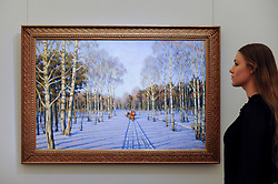 "© Licensed to London News Pictures. 02/06/2017. London, UK. A staff member views ""A Beautiful Day"", 1952, by Konstantin Yuon. (Est. 120-180k).  Preview of Sotheby's sale of Russian pictures and works of art which takes place on 6 June 2017 at Sotheby's in New Bond Street. Photo credit : Stephen Chung/LNP"