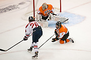 RIT's Jordan Ruby makes a save during a game at the Gene Polisseni Center on Saturday, October 4, 2014.